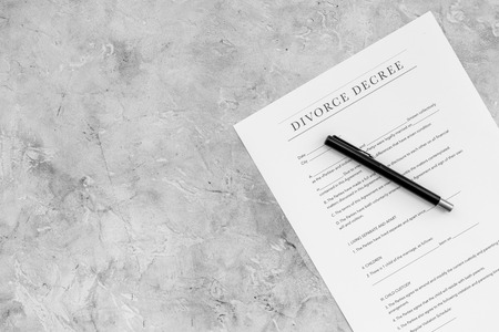 Divorce decree. Document on grey backgroud top view copy space
