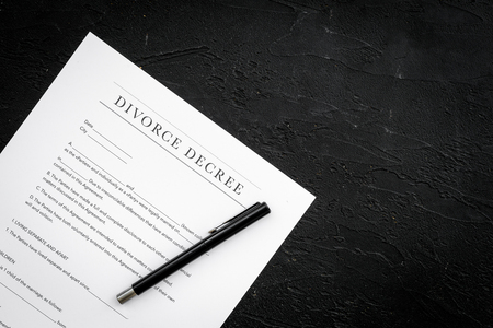 Divorce decree. Document on black backgroud top view space for text