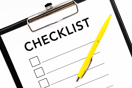 blank checklist with space for ticks on pad on office desk