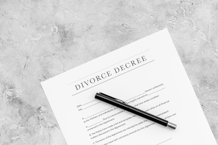 Divorce decree. Document on grey background top view.