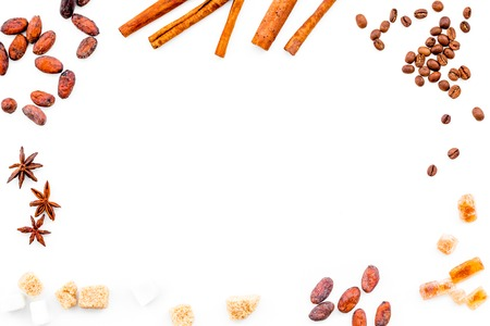 Ingredients for bakery and desserts. Cinnamon, cocoa, sugar, spices on white background top view. Stock Photo