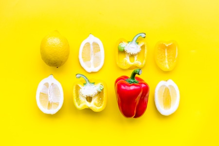 Layout made of lemons and yellow bell pepper. Food concept. Lemon pattern on yellow background top view.
