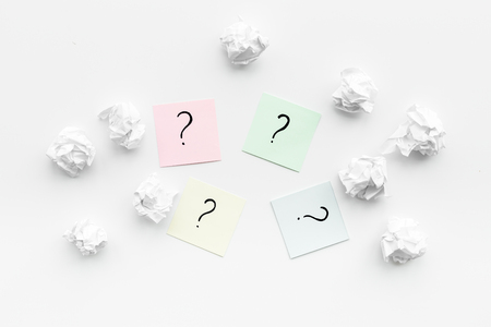 FAQ concept. Question mark on sticky notes near crumpled paper on white background top view Zdjęcie Seryjne - 100179768