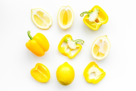 Layout made of lemons and yellow bell pepper. Food concept. Lemon pattern on white background top view copy space
