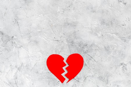 Divorce concept. Sign of divorce. Broken heart on grey background top view copy space