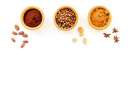 Flavoring products for making desserts. Cinnamon, cocoa, coffee on white table top view space for text Stock Photo