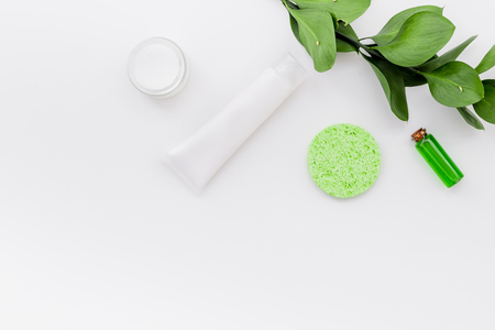 Hypoallergenic moisturizing cosmetics for face care. Lotion, cream, oil on white background top view.