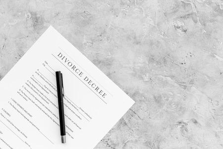 Divorce decree. Document on grey background top view.