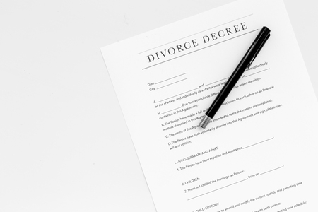 Divorce decree. Document on white backgroud top view.
