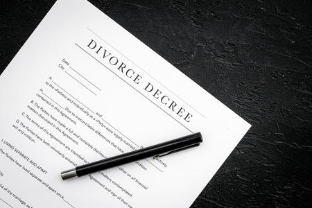 Divorce decree. Document on black backgroud top view. Imagens