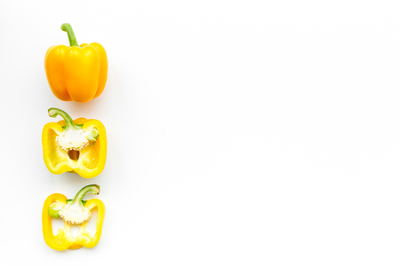 Layout of yellow sweet bell pepper slices on white background top view. Imagens