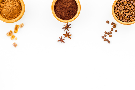Ingredients for bakery and desserts. Cinnamon, cocoa, coffee, sugar, spices on white background top view space for text