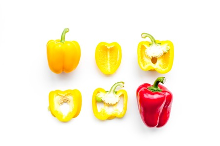Layout of red and yellow sweet bell pepper slices on white background top view pattern 版權商用圖片