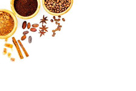 Seasoning for cooking desserts. Cinnamon, cocoa, badian, coffee on white background top view copy space Stock Photo