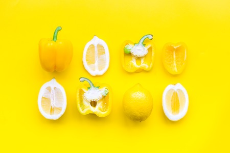 Layout made of lemons and yellow bell pepper. Food concept. Lemon pattern on yellow background top view