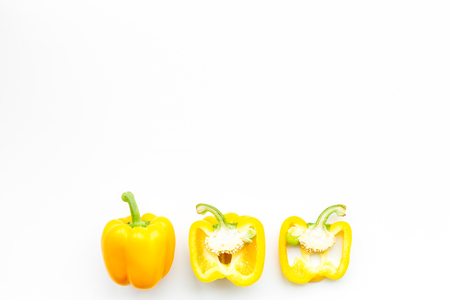 Layout of yellow sweet bell pepper slices on white background top view copy space 版權商用圖片
