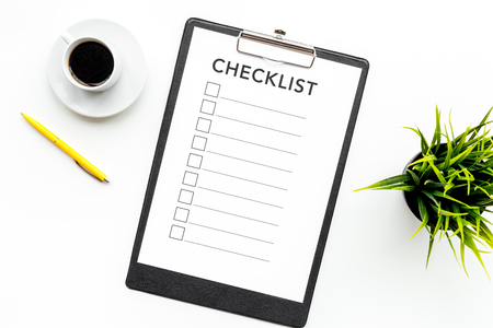 Blank checklist with space for ticks on pad on office desk. Checklist for office worker, manager, businessman, chief on white background top view.