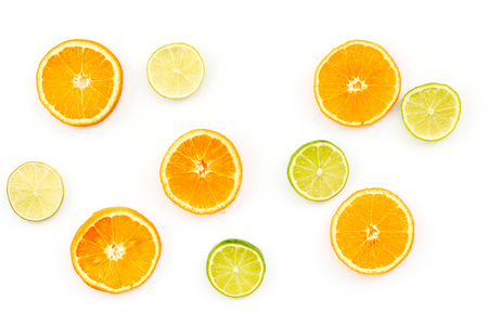Oranges and lime round slices pattern on white background top view.