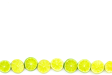 Lime round slices pattern on white background top view. Banco de Imagens - 101346038