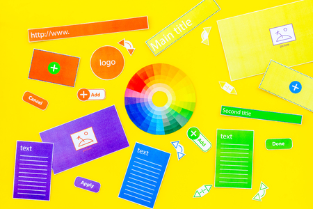 Developing internet site. Website design concept. Elements, blocks, instruments, tools for make site on yellow background top view.