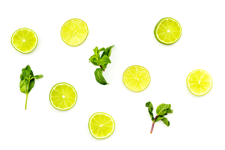 Fruit pattern. Lime round slices composition on white background top view