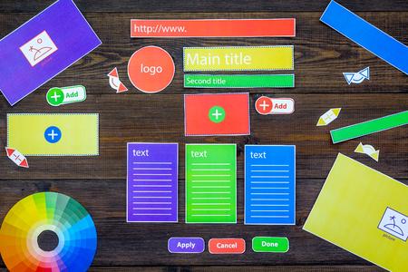 Developing internet site. Website design concept. Elements, blocks, instruments, tools for make site on dark wooden background top view Stok Fotoğraf