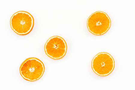Citrus pattern. Orange round slices composition on white background top view