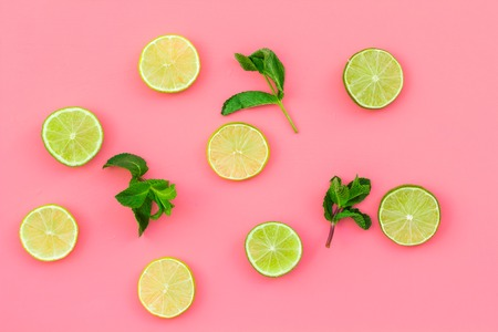 Fruit pattern. Lime round slices composition on pink background top view