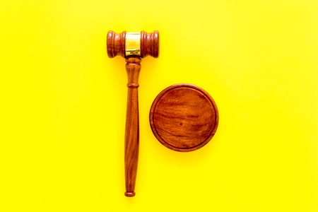 Lawyer or attorney concept. Judge gavel on yellow background top view copy space