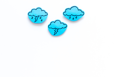 Rainfall forecast concept. Weather icons. Rainy cloud, lightening on white background top view copy space Stock Photo