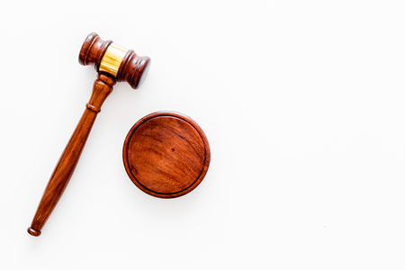 Law or jurisprudence concept. Judge gavel on white background top view copy space