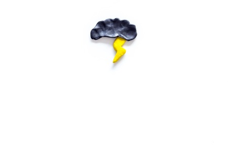 Storm weather concept. Air temperature. Cloud and lightening on white background top view copy space