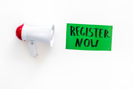 Register now hand lettering icon near megaphone on white background top view.