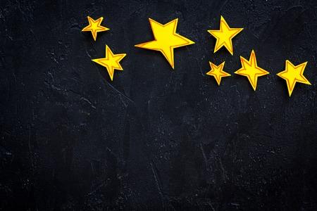 Stars frame. Drawn stars on black background top view. Stock Photo