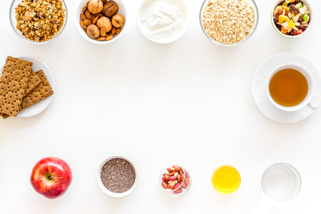 Ingredients for healthy breakfast on white background top view. Stock Photo