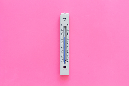 Thermometer for measuring temperature outdoor on pink background top view.