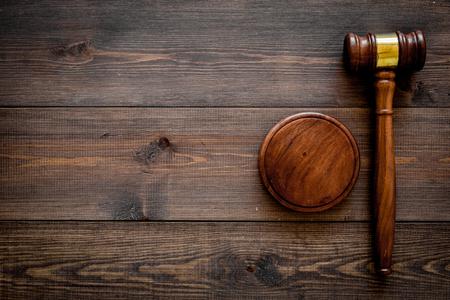Law or jurisprudence concept. Judge gavel on dark wooden background top view.