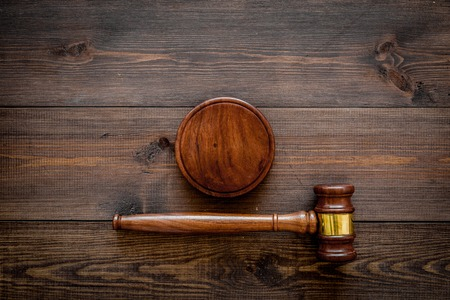 Law or jurisprudence concept. Judge gavel on dark wooden background top view copy space