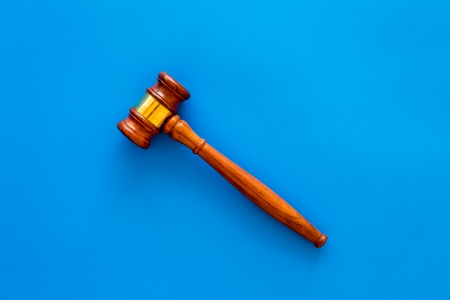 Law and court. Lawyer, attorney, judge concept. Judge gavel on blue background top view copy space