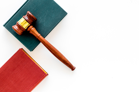 Law student concept. Judge gavel and vintage books on white background top view copy space Фото со стока