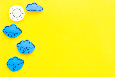 Modern weather icons set on yellow background top view copy space Imagens