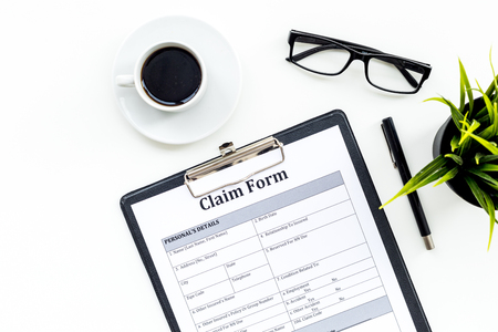 Claim form to fill out on white desk top view Stock Photo