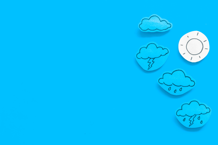 Modern weather icons set on blue background top view copy space
