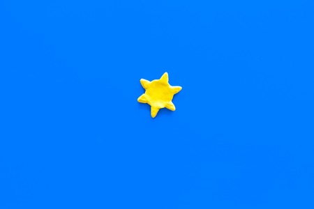 Clear weather concept. Sunny. Sun on blue background top view copy space