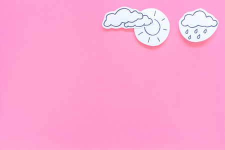 Rainfall forecast concept. Weather icons. Rainy cloud, lightening on pink background top view copy space Stock Photo