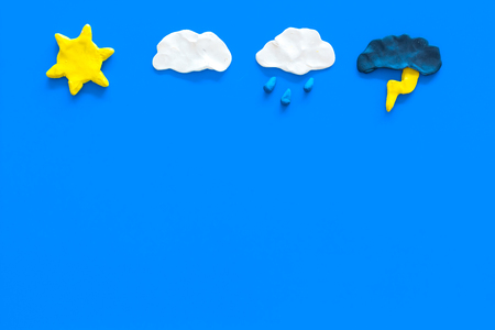 Modern weather icons set on blue background top view. Reklamní fotografie