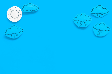 Modern weather icons set on blue background top view. Imagens