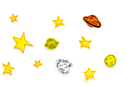 Space concept. Drawn stars, planets, asteroids on white outer space background top view.