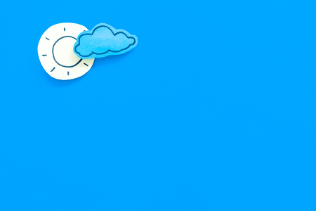 Clear and cloudy weather icons on blue background top view copy space Imagens