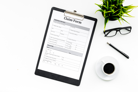 Claim form to fill out on white desk top view space for text